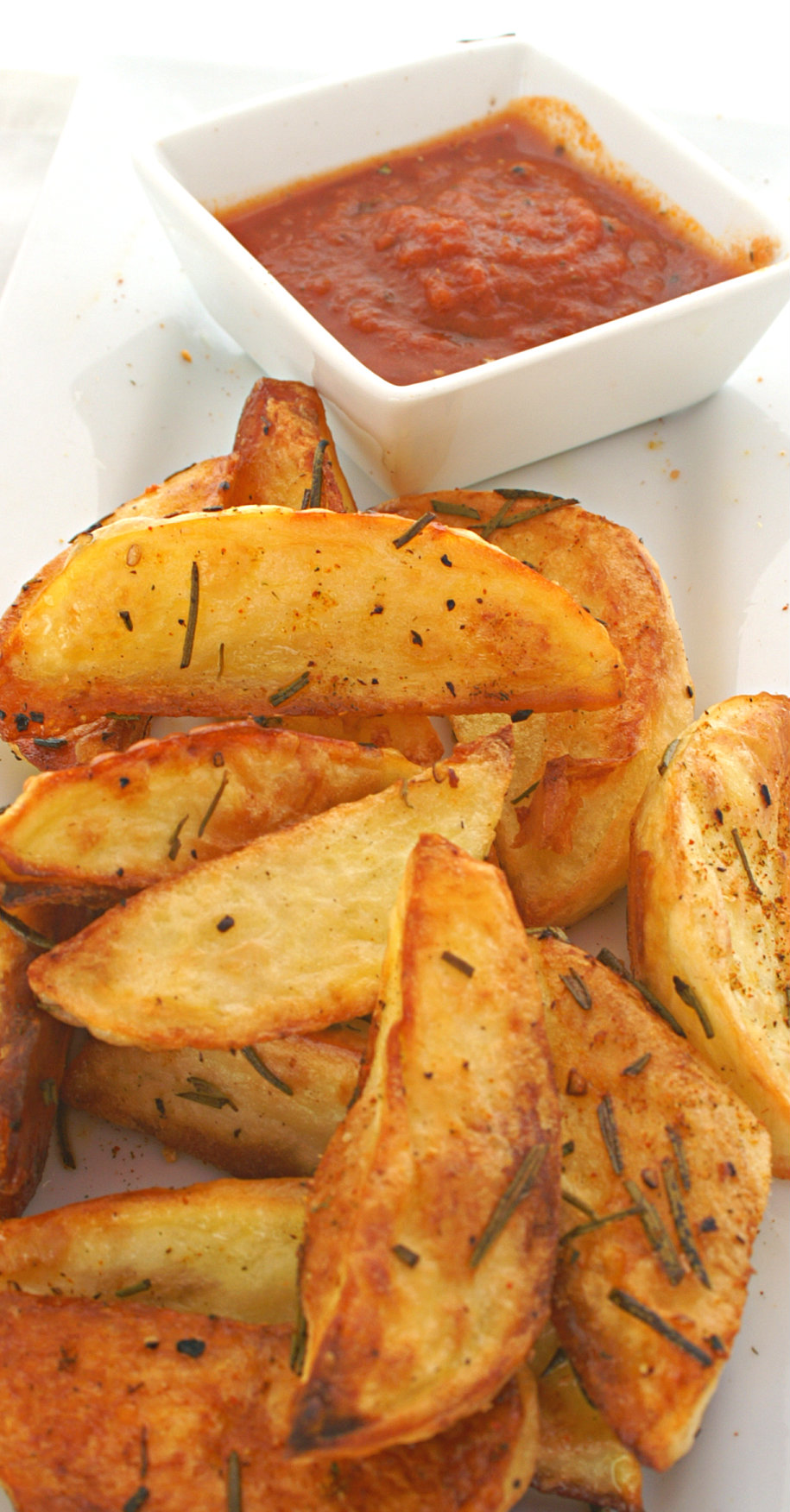 Rosemary Roasted Garlic Potato Wedges | Going Cavewoman